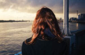 Woman looking out at River